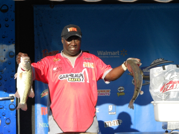 Tommy Robinson on stage with some of his winning bass